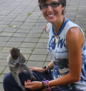 Girls Who Travel | Author Coutrney holds a small grey monkey