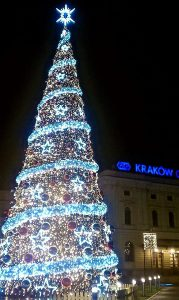 Girls Who Travel | The first snowfall of the year begins around a lit Christmas tree in Krakow.